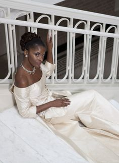 White and Gold Wedding. African American. Black Bride. Off the shoulder wedding dress with a huge, glamorous bow!