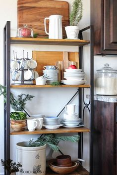 Our Christmas Home Tour (Part 2) - The Wood Grain Cottage // love the idea of a tall open shelf unit like this in the kitchen for dinnerware, etc.