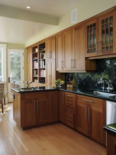 Oak cabinets with black countertops.