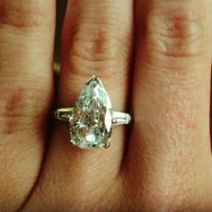 simply perfect.  Pear shaped diamond  gorgeous engagement ring