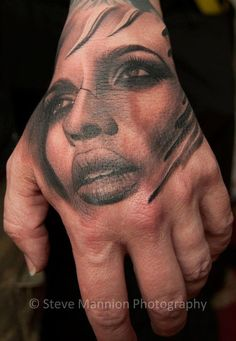 Woman's Face Hand Tattoo