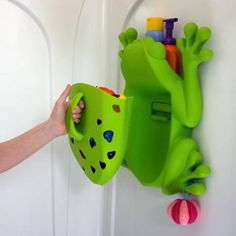 """For organizing our bath toys. Incidentally it can hold a razor out of the way in the little hole on the frog's back and you can hang a shower poof thing off of the frog's fingers."""