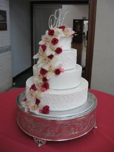 Cascading cake flowers added on site