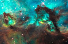 It may look like a seahorse, but the dark object is actually a pillar of smoky dust about 20 light-years long. The structure occurs in our neighbouring Large Magellanic Cloud, in a star-forming region near the Tarantula Nebula