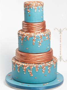 bold blue and bronze ombre tiered cake