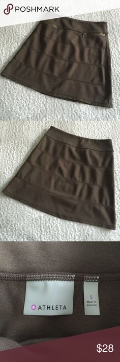 Athleta Skirt Like new.  See photos for measurements.  Color is hard to describe.  Not green, not brown, somewhat of an olive color depending on lighting. Athleta Skirts