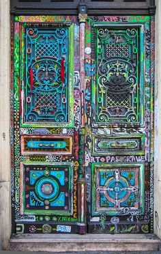 Art Gallery Entrance, Montmartre, Paris, France: Street art is very popular in Paris. This door is an elaborate display of colorful designs and patterns. Upon closer inspection you can see all of the words that give this door even more symbolic meaning. Cool Doors, The Doors, Unique Doors, Windows And Doors, Front Doors, Barn Doors, Pivot Doors, Bay Windows, Sliding Doors