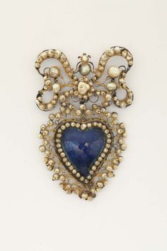 An enamel and pearl ex-voto