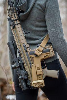I like the sweater and the gun. Wrap 'em up! #womenthatshoot #guns