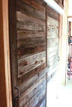 I love the horizontal lines in this reclaimed wood door. Gives me ideas on how to utilize the shorter cutoff boards from other orders. There really are very few wasted pieces when you are dealing with reclaimed wood. Double Sliding Doors, Barn Style Sliding Doors, Reclaimed Wood Door, Barn Wood, Weathered Wood, Pallet Door, Diy Pallet, Barn Door Sliders, Door Kits