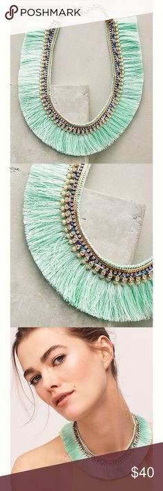 """STUNNING Anthropologie Necklace. NWOT. The Corsican Bib Necklace is made of mint green silky """"tribal"""" fringe and militia-colored beads and gems on its inner edges. All displayed beautifully on a golden chain. Flawless design and so unique!! Anthropologie Jewelry Necklaces"""