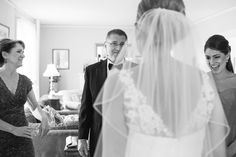 Emotional father  of the bride sees his beautiful daughter  for the first time on her wedding day .