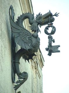 Béla Hikman locksmith sign - Hungary, 1931 - dragon with key in its mouth  (via hilonegro)