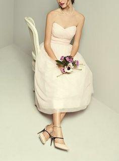 This blush tulle tea-length bridesmaids dress is so pretty.