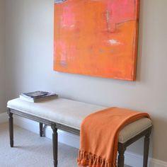 orange throw and artwork
