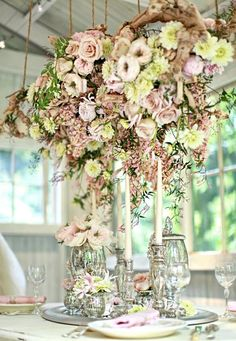 A suspended centerpiece with spring-soft colors.  I love this, but we would have to select items that could last the whole fair.