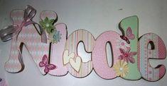 Nome em MDF, decorado em papel de scrap.  Pode ser utilizado para decorar quarto, porta de maternidade e festa infantil.  Fazemos nas cores desejadas R$ 67,00