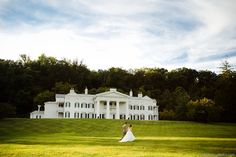Our Leesburg wedding venue includes this Greek revival mansion, a rustic coach house and  a one-of-a-kind carriage museum.