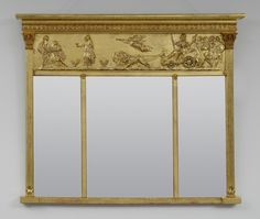 Victorian giltwood overmantle mirror with three beveled mirror plates, a classical frieze below a molded cornice with applied decoration, reeded flat columns topped by Corinthian capitals.      English Circa 1870     Height: 39.5"