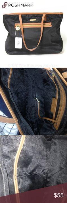Inside Michael Kors bag Nice clean inside. No tips or tears Michael Kors Bags Totes