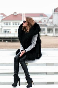 Oversized fur coat with leather pants and heels