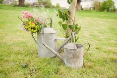 Watering can flowers Keeble Wedding Collection Photo By Big Fish Photography