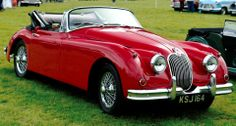 Reminds me of the Jag we used to have when I was a kid but in a very cool red convertible!