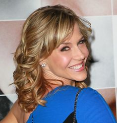 Julie Benz  Medium Funky Blonde Wavy Curly Hairstyle.. thinking this would look awesome in dark red