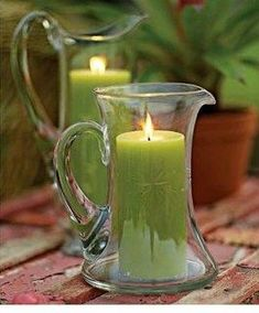 Wedding centerpieces-I love these vintage pitchers repurposed as hurricanes. Chandelier Bougie, Chandeliers, Candels, Candle Lanterns, Green Candles, Sage Candles, Fragrant Candles, Hurricane Lamps, Unique Candles