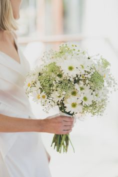 Hand held daisy and baby's breath bouquet with touches of Queen Anne's Lace…