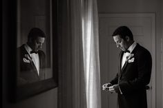 Silent moment with Groom before he sees his Bride / Wedding of Lauren & Willie at The Biltmore Hotel Miami Florida / Photo by Maloman Studios