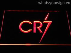 Real Madrid CF Cristiano Ronaldo CR7 Logo - Neon sign LED display made of the first-class quality transparent plastic and bright colorful LED glow. The neon sign displays exactly the same from all angles thanks to the carving with the modern 3D laser engraving process. This LED neon sign is a great gift idea! The neon is provided with a metal chain for displaying. Available in 3 sizes in following colours: Red, White, Orange, Blue, Yellow, Purple and Green!