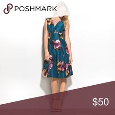 Teal Floral Dress Gorgeous print and color. Lightweight material. 100% Polyester but reminds me of Dupioni Silk! Worn once. Excellent, like-new condition! Runs small in my opinion. Fit me when I was between 12/14. Dress Barn Dresses Midi