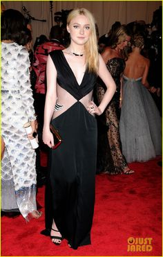 Dakota Fanning wears a sheer dress while walking the red carpet at the 2013 Met Gala held at the Metropolitan Museum of Art on Monday (May 6) in New York City. …