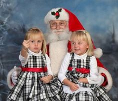 Looks like some little girl made Santa's naughty list.   ~~ 25 Creepy Family Christmas Photos