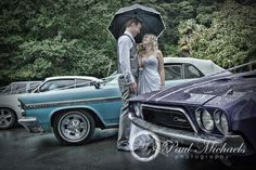 Couple in the rain with the wedding cars at Wallaceville house. PaulMichaels Wellington wedding photography http://www.paulmichaels.co.nz/