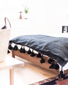 Moroccan Wool Pom Pom blankets are great throw blanket for the end of a bed or a couch.