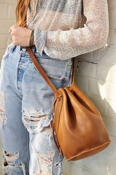 $140, Tan Leather Crossbody Bag: Baggu Leather Drawstring Bucket Bag. Sold by Urban Outfitters. Click for more info: http://lookastic.com/women/shop_items/60022/redirect