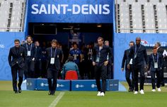 Head coach Antonio Conte (C) attends a pitch walkabout at Stade de France on June 26, 2016 in Paris, France.