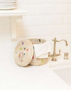 This charming basket is perfect for holding your hand towels and miscellaneous bathroom items.
