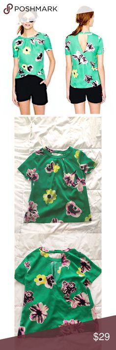 • J.Crew Phunk in Floral • Size = XS petite, green punk in floral Blouse from J Crew , silky appearance, buttons around neck area on backside, also has a swoop in back with cut out, for a classy look.  ~ I DO NOT SWAP, SO PLEASE DON'T ASK. YOU WILL BE IGNORED.  ~ I NO LONGER HOLD MY ITEMS, FIRST COME FIRST SERVE.   ~YOUR PURCHASE WILL BE SHIPPED WITHIN 24-48 HOURS AFTER PURCHASED  ~I AM MORE THAN HAPPY TO MAKE YOU A BUNDLE. J. Crew Tops Blouses