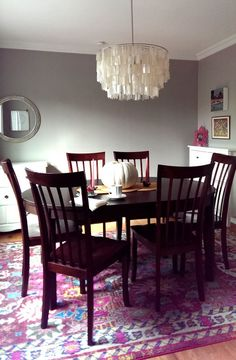 """""""Silverfox"""" paint by Benjamin Moore, Capiz shell light fixture, and Barcelona area rug from Wayfair in my refreshed dining room."""