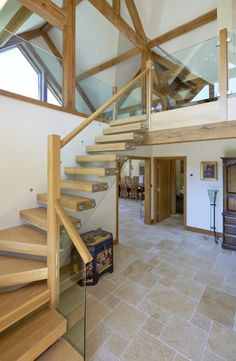 The floating staircase that leads from the open living hallway to the upstairs bedrooms and snug area. | Oakwrights