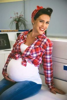 Show your girl power wearing a Rosie the Riveter Pin up maternity costume this Halloween. All you need to DIY this costume is a bandana for your hair, a plaid flannel shirt, a maternity top and jeans. You will look like a WWII pin up girl.