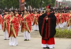 Students of Qing'an High School attend a traditional adulthood ceremony in Xi'an, capital of northwest China's Shaanxi Province, May 1, 2014. Students dressed in Hanfu, a traditional Chinese clothing, participated in the ceremony marking their growing up.