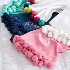 Monogrammed pom pom throw