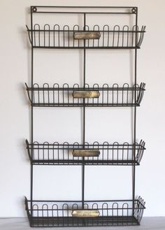 Measures 15 inches wide and 27 inches tall. Mounting hardware is included. Bottom basket stands 5½ inches out from the wall, top basket stands 3 inches out from the wall. Attached numbered brass tags