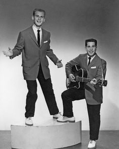 """11-22 in 1957: Paul Simon and Art Garfunkel make their first appearance on ABC-TV's dance show American Bandstand -- in their earlier incarnation as Tom and Jerry, playing their minor hit """"Hey Little Schoolgirl."""""""