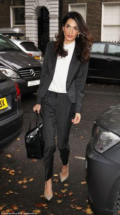 Smart suit: Amal Clooney looked amazing in a pinstriped jacket and trousers as she headed out to work in London on Monday morning