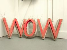 wow = mom turned upside down. MY SONS used to turn mom sign upside all the time. Brought back great memories